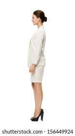 Full-length profile of businesswoman, isolated on white. Concept of leadership and success