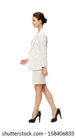 Full-length profile of walking businesswoman, isolated. Concept of leadership and success