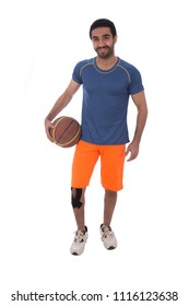 Full-length shot of a basketball player holding the ball smiling with an injured knee, isolated on a white background.