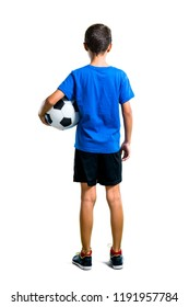 A full-length shot of Boy playing soccer in back position on isolated white background