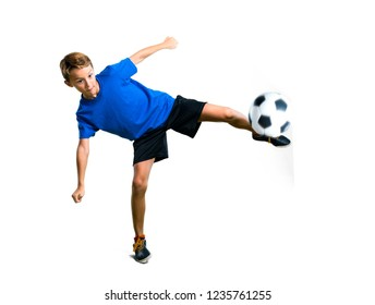 A full-length shot of Boy playing soccer kicking the ball on isolated white background
