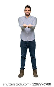 Full-length shot of Elegant man with shirt holding copyspace imaginary on the palm to insert an ad on isolated white background