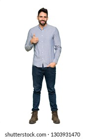 Full-length shot of Elegant man with shirt giving a thumbs up gesture with both hands and smiling on isolated white background