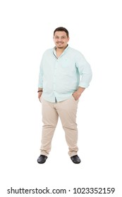 A full-length shot of a fat young man standing hands in pocket, isolated on a white background.