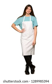 Full-length shot of Girl with apron posing with arms at hip and smiling on isolated white background