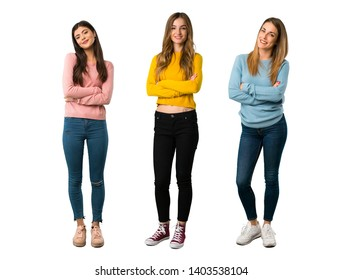A full-length shot of a group of people with colorful clothes keeping the arms crossed in frontal position on isolated white background on isolated white background