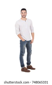 Full-length shot of handsome happy young man with hands in pocket. Isolated on white background.