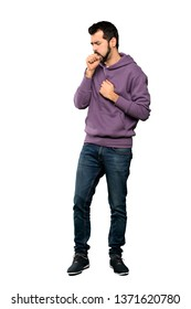 Full-length shot of Handsome man with sweatshirt is suffering with cough and feeling bad over isolated white background