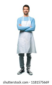 A full-length shot of a Man wearing an apron keeping the arms crossed in frontal position. Confident expression on isolated background
