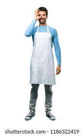 A full-length shot of a Man wearing an apron makes funny and crazy face emotion on isolated background
