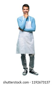 A full-length shot of a Man wearing an apron smiling and looking to the front with confident face on isolated background