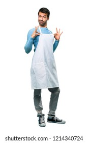 A full-length shot of a Man wearing an apron proud and self-satisfied in love yourself concept on isolated background