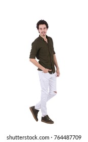 Full-length shot of simple display model  with hands in pocket. He is wearing Army green shirt and white trousers. Isolated on white background.