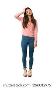 A full-length shot of a Teenager girl with pink shirt with an expression of frustration and not understanding