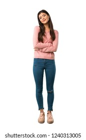 A full-length shot of a Teenager girl with pink shirt keeping the arms crossed in frontal position