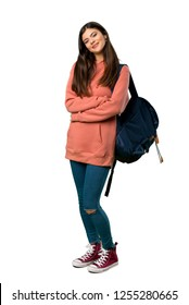 A full-length shot of a Teenager girl with sweatshirt and backpack keeping the arms crossed in frontal position