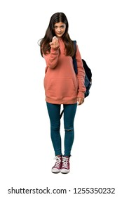 A full-length shot of a Teenager girl with sweatshirt and backpack inviting to come with hand. Happy that you came