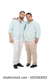 A full-length shot of two unfitness friends standing hands on shoulder, isolated on a white background.