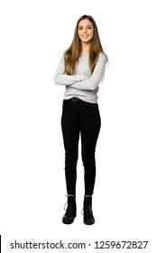 Full-length shot of young girl keeping the arms crossed in frontal position on isolated white background