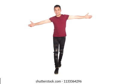 full-length shot of a young man walking hands wide open, want to hug someone, isolated white background