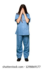 Full-length shot of Young nurse with tired and sick expression on isolated white background