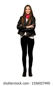 Full-length shot of Young woman with leather jacket keeping the arms crossed in frontal position on isolated white background