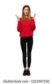 A full-length shot of a Young woman with red sweater frustrated by a bad situation over isolated white background