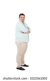 A full-length of a side view shot of a fat young man standing crossed arms, isolated on a white background.