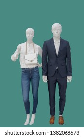 Full-length two mannequins, male and female, dressed in fashionable clothes, isolated. No brand names or copyright objects.