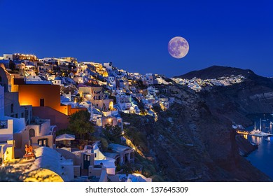 fullmoon above Santorini island in Greece