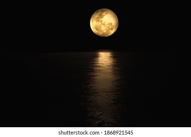 fullmoon at black sky and dark sea