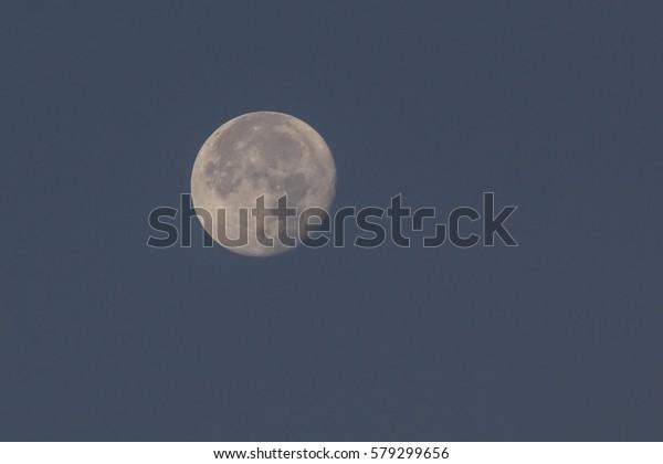 fullmoon-blue-sky-600w-579299656.jpg