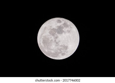 Fullmoon phase on July 25, 2021. Closeup of the super fullmoon in the summer Full moon Total Lunar in night dark shining bright texture isolated on black back