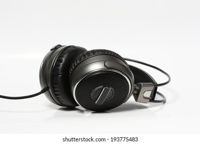 full-size headphones in a uniform background of