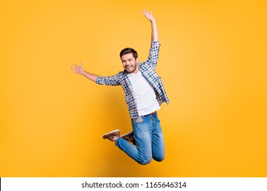 Full-size portrait of attractive well-dressed nice-looking man in jump isolated on shine yellow background