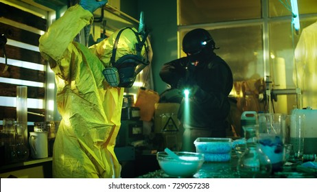 Fully Armed Special Anti-Narcotics Task Forces Soldier Arrests Clandestine Chemist in the Drug Producing Underground Laboratory. Chemist Raises Hands and Surrenders.