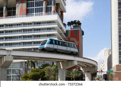 The fully automated Miami downtown train system with the city in the background