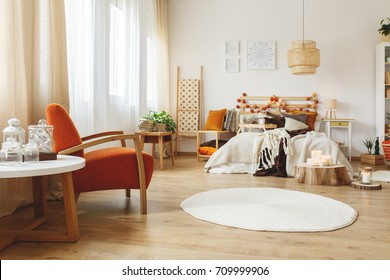 Fully furnished cozy spacious bedroom with wooden furniture