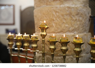 """A fully lit """"menorah"""" (candelabrum) used as a Jewish ritual on the holiday of Hanukkah using olive oil"""