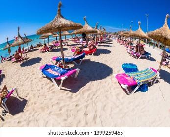Fully occupied beach on the Playa de Palma, Ballermann, tourist center of Mallorca, El Arenal, Balearic Islands, Spain, Aug 2014