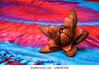 A fully open skyfruit flower of the mahogany tree on a colorful cloth background. Used in alternative medicine as an herbal remedy.