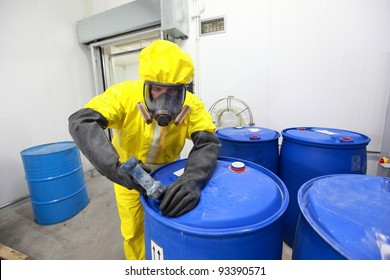 fully protected in yellow uniform,mask,and gloves professional dealing with chemicals