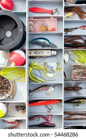 A fully stocked fisherman's tackle box fully stocked with lures and gear for fishing.