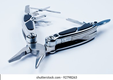 Fully unfolded multi tool on white background