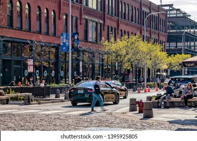 Fulton Market, Chicago-May 4, 2019: People enjoy the restaurants and streetscape along the popular Fulton Market Street. Main street in Chicago.