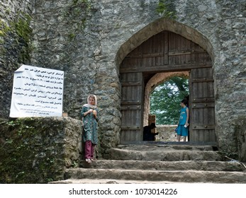 Fuman, Iran - July 18, 2017 : Tourists at the entrance of Rudkhan castle, a stone medieval fortress in Gilan province, northern Iran.