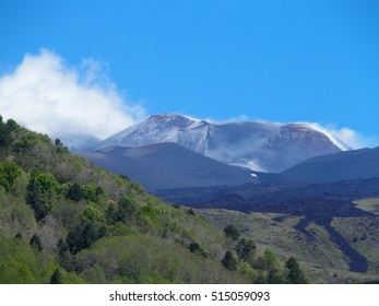 Fuming ETNA in SICILY, tallest active volcano in EUROPE, lava frozen in place with clear blue sky in warm and sunny spring day: ITALY on MAY 2016.