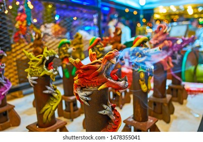 The fuming incense censers on the counter of stall in Night Market in shape of animals, birds and mythic creatures, Chiang Mai, Thailand