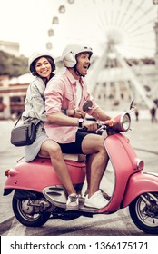 Fun activity. Nice happy man feeling excited while riding a motorcycle