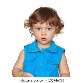 Fun baby girl looking in blue dress. Isolated closeup portrait